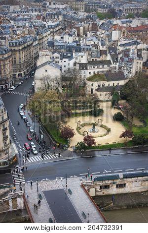 View of the Pont au Double, Square Rene Viviani, Rue Lagrange and Quai de Montebello. Paris. France