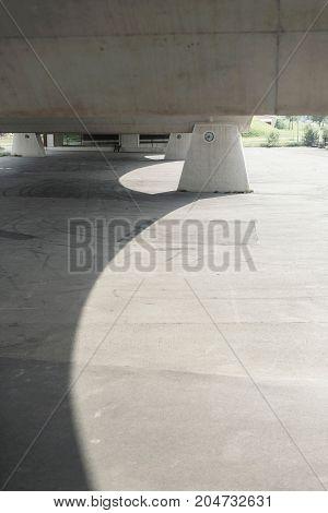 Concrete construction from bottom of a bridge.