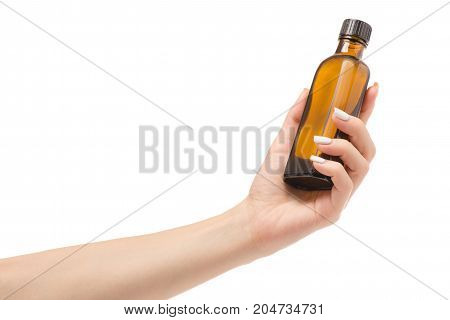 Female hands medicine tincture syrup on white background isolation