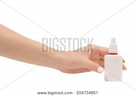 Female hands medicine nose spray on white background isolation