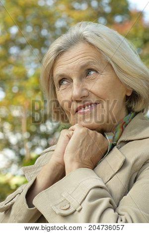 Portrait of a happy senior beautiful woman posing outdoors