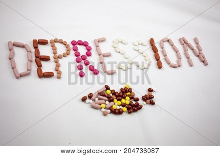 A Depression Word, Writing On The White Background On Pills