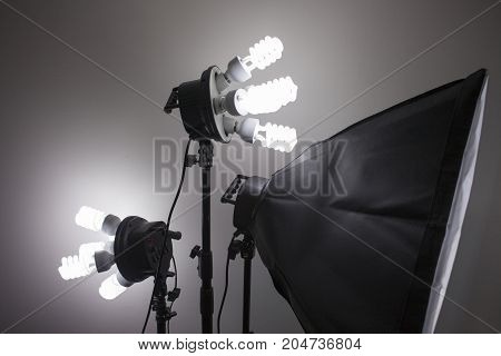 A studio equipment lighting illuminated on the background