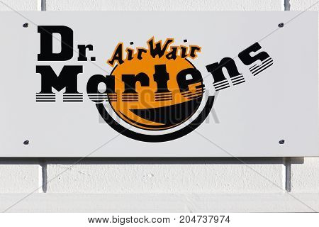 Merignac, France - June 5, 2017: Dr. Martens logo on a wall. Dr. Martens is a British footwear and clothing brand, which also makes a range of accessories