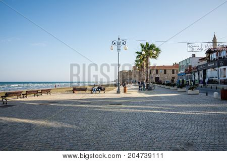 Larnaca, Cyprus, March 2017: A small square and esplanade near Larnaca Castle and beach Cyprus