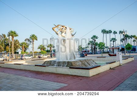 Larnaca, Cyprus, March 2017: A fountain in Europe square near Larnaca Marina and Finikoudes beach Cyprus