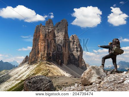 Drei Zinnen or Tre Cime di Lavaredo with hiker Sextener Dolomiten or Dolomiti di Sesto South Tirol Dolomiten mountains view Italien Alps