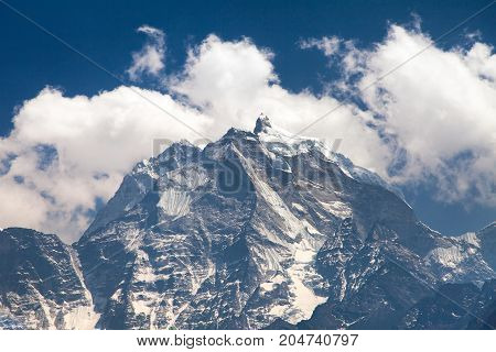 View of mount Kangtega in the middle of clouds one from the best mouns around Namche Bazar Khumbu valley Sagarmatha national park Nepalese Himalayas Nepal
