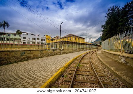 QUITO, ECUADOR AUGUST 20 2017: Close-up of railway at the train station of Chimbacalle Quito in Pichincha. It is the starting point of many luxury train journeys in the volcanic area.