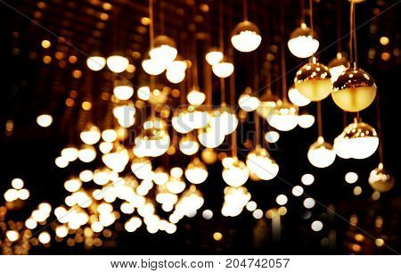 lamp white light hanging in bar or pub party in the dark night city background