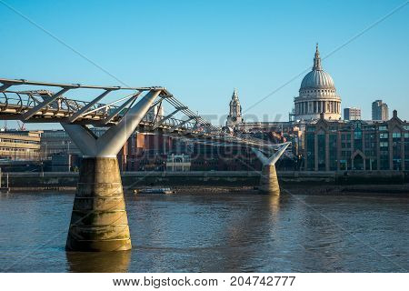 London, England, April 2017: A view of London Millennium Bridge and St Paul's Cathedral from Bankside in South Bank of Thames River
