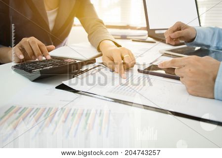 Investor executive discussing plan financial graph data on office table finance accounting investment meeting.