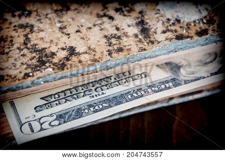 Bill of hundred American dollars hidden in an old book