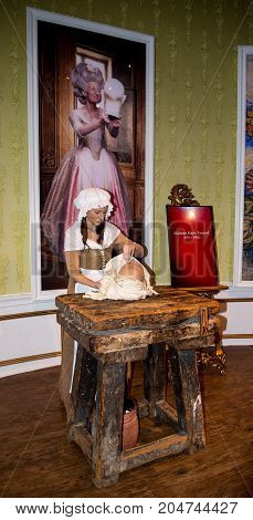 London, England, April 2017: Marie Tussaud at work wax statue in museum in London England