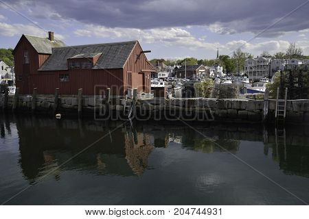 Rockport Massachusetts waterfront with reflections and cloudy sky