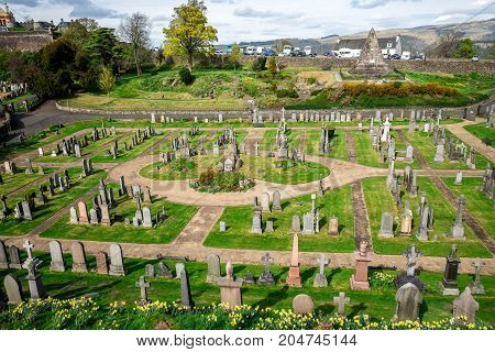 Stirling, Scotland, April 2017: A view to the cemetery between Stirling Castle and Church of Holy Rude Scotland