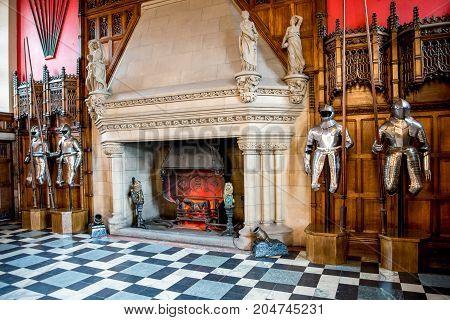Edinburgh, Scotland, April 2017: Knights armor and a large fireplace inside of Great Hall in Edinburgh Castle Scotland