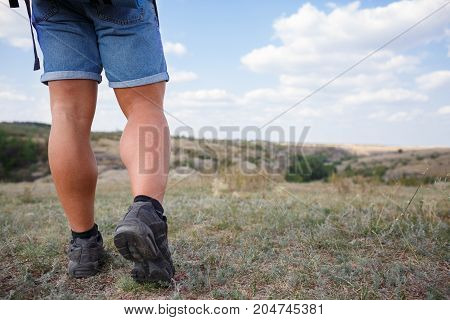 Traveler Feet hiking in mountains Travel Lifestyle adventure active summer vacations outdoor concept