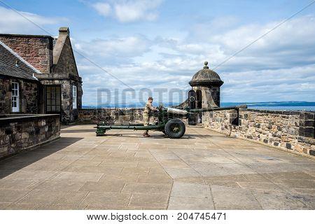 Edinburgh, Scotland, April 2017: A gunner is servicing One O'Clock gun in Edinburgh Castle Scotland
