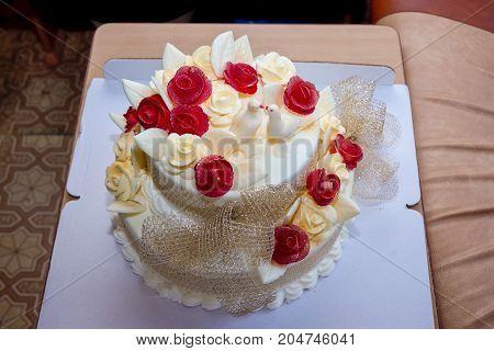 Wedding cake with red and white roses and doves