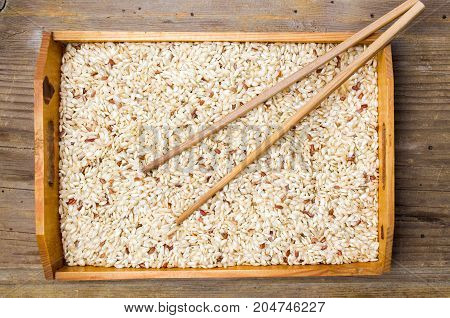 Yellow Rice And Wooden Chopsticks