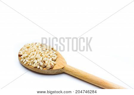 Yellow Rice Seeds In A Wooden Spoon