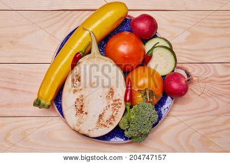 Healthy food delivery background. Lunch layout with colorful tomatoes, zucchini, pepper.