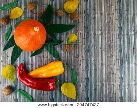 Tasty appetizing fresh autumn seasonal vegetables on old wooden background. Flat lay style.