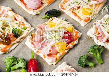 Homemade Pizza Sandwiches On A Baking Paper