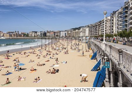 San Sebastian Spain - June 7 2017: People at the La Concha beach in San Sebastian Donostia. Basque country Spain