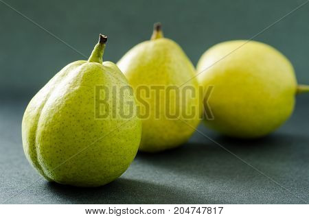 Fresh pears fruit on green background,healthy fruit