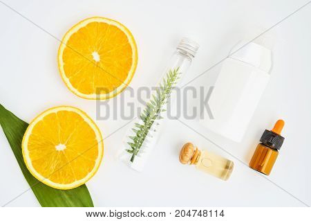 Ingredients of skin care products. And honey in the glass Blank label package for mockup on white background and flowers. The concept of natural beauty products.
