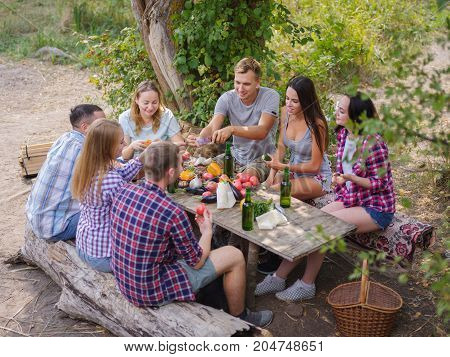 A merry company of young friends having fun outdoors. Summer time.