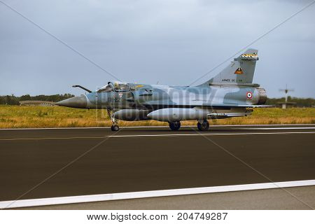 Schleswig - Jagel Germany - June 19 2014: French Air Force Dassault Mirage 2000 board number118-EZ is taxiing on strip of airbase Schleswig - Jagel during NATO Tiger Meet 2014.