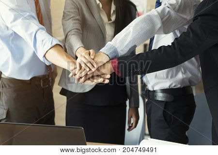 Business team stack hands in the meeting room support concept