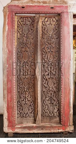 ancient temple door at thailand - stock image