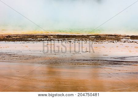 Close up of the Grand Prismatic Spring at eye level in Yellowstone National Park.