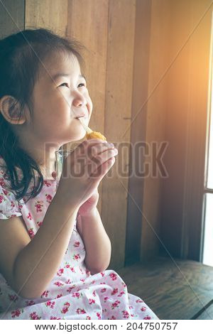 Asian Child Smiling And Enjoy Eating Breaded Mozzarella Cheese Sticks.