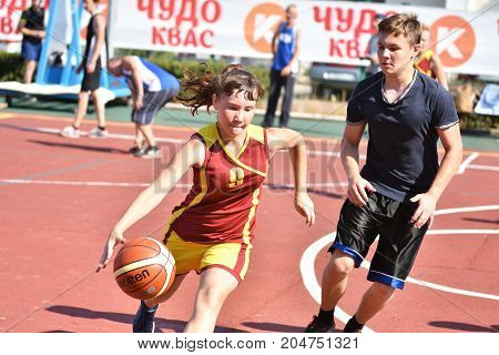 Orenburg, Russia - July 30, 2017 Year: Girls And Boys Play Street Basketball