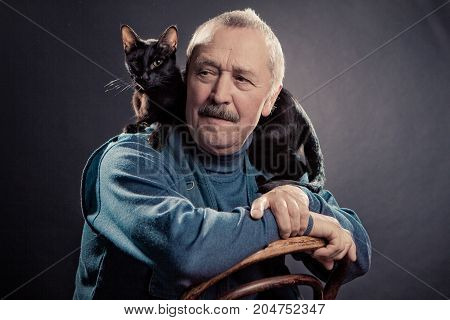 portrait of an old men with cat