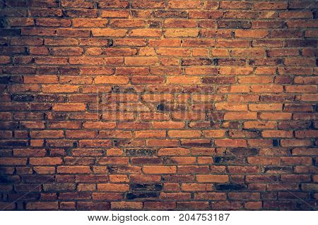 Old grunge brick wall background. Texture of stained old dark red brick wall background colorful horizontal architecture natural color for your text. Vignette effect.