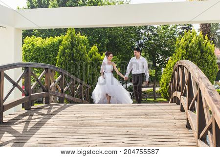 honeymoon couple travel sea and beach resort in Europe. Bride and groom walking together.
