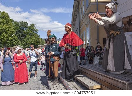 TURKU, FINLAND ON JUNE 30. Performance, street theater, acting during the Medieval Market and Festival on June 30, 2017 in Turku, Finland. Unidentified people in the street. Editorial use.