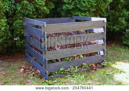 Compost frame in the garden made of recycled plastic