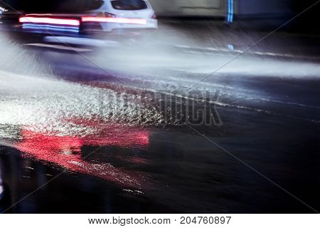 Car In Motion During Heavy Rain And Water Splashes. Blurred View.
