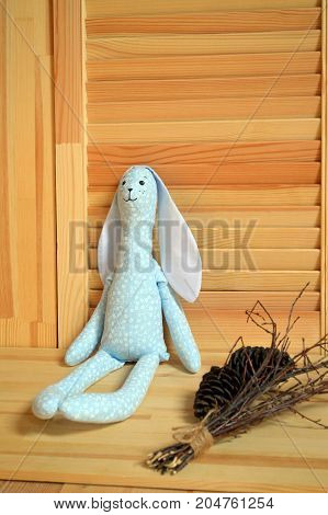 stitched stuffed toys for babies on a wood background