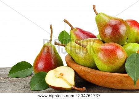 Pear With Leaf In Wooden Bowl On Old Wooden Table With White Background