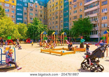Kyiv, Ukraine - May 21, 2017: The children paying at children's playground at Kyiv, Ukraine on May 21, 2017