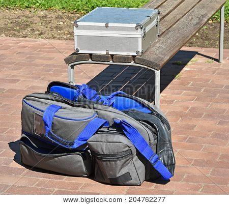 Video camera bag next to a bench