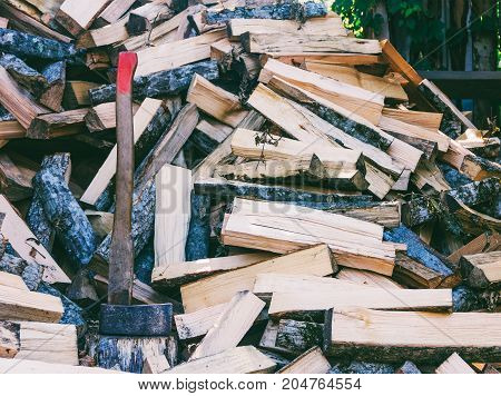 axe cleaver and a bunch of chopped beech hornbeam and ash firewood for the stove and fireplace